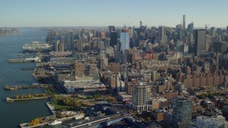 AX119_024 - 6K stock footage aerial video of piers and riverfront buildings in Chelsea and skyscrapers in Midtown, New York City