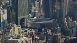 AX119_025 - 6K stock footage aerial video of orbiting Madison Square Garden Arena in Midtown, New York City