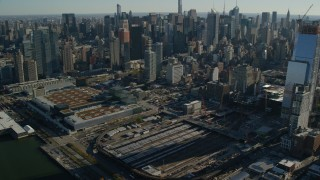 AX119_026 - 6K stock footage aerial video of convention center and West Side Yard in Hell's Kitchen in Midtown, New York City