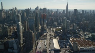 AX119_028 - 6K stock footage aerial video flyby convention center and skyscrapers in Hell's Kitchen in Midtown, New York City