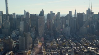 AX119_029 - 6K stock footage aerial video of skyscrapers in Hell's Kitchen in Midtown, New York City