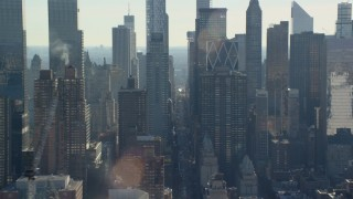 AX119_030E - 5.5K stock footage aerial video of flying by skyscrapers in Hell's Kitchen in Midtown, New York City