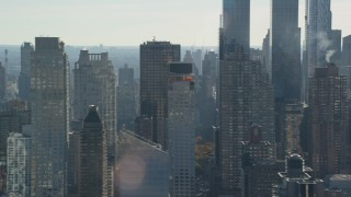 AX119_031 - 6K stock footage aerial video flyby skyscrapers in Hell's Kitchen and Upper West Side in Autumn, New York City