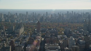 AX119_034 - 6K stock footage aerial video of Central Park between high-rises on the Upper West and Upper East Side in Autumn, New York City