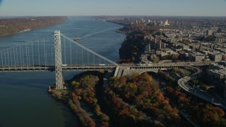 AX119_044 - 6K stock footage aerial video of an approach to the George Washington Bridge in Autumn, New York City