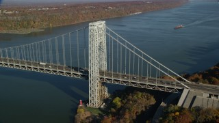 AX119_045 - 6K stock footage aerial video of orbiting the George Washington Bridge in Autumn, New York City