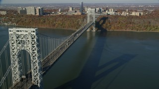 AX119_046 - 6K stock footage aerial video of an orbit of the George Washington Bridge in Autumn, New York City
