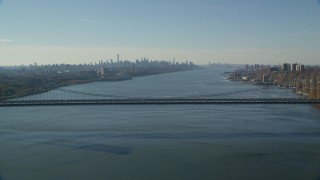 AX119_048 - 6K stock footage aerial video of the Midtown skyline seen from George Washington Bridge in Autumn, New York City