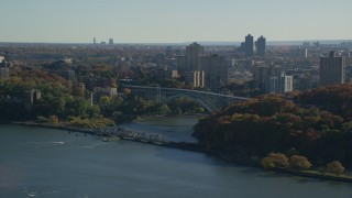 AX119_054 - 6K stock footage aerial video of the Henry Hudson Bridge in Autumn, The Bronx, New York City