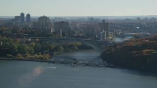 AX119_055 - 6K stock footage aerial video orbit Henry Hudson Bridge in Autumn, The Bronx, New York City