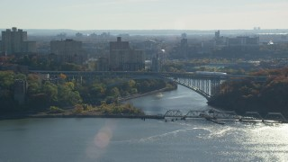 AX119_056 - 6K stock footage aerial video of an orbit of Henry Hudson Bridge in Autumn, The Bronx, New York City