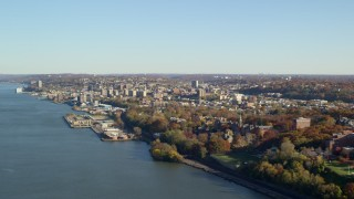 AX119_060 - 6K stock footage aerial video approach Yonkers by the Hudson River in New York in Autumn