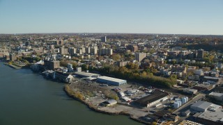 AX119_063 - 6K stock footage aerial video of the riverfront downtown area of Yonkers, New York in Autumn