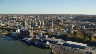 AX119_063E - 5.5K stock footage aerial video of the riverfront downtown area of Yonkers, New York in Autumn