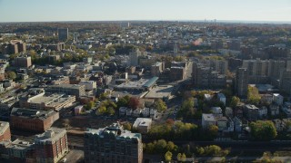 AX119_065 - 6K stock footage aerial video orbit downtown area of Yonkers, New York, in Autumn