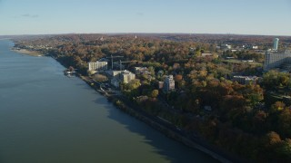 AX119_071 - 6K stock footage aerial video of riverfront apartment buildings in Autumn, Yonkers, New York