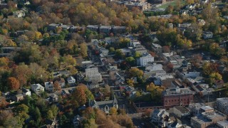 AX119_080 - 6K stock footage aerial video of small town shops in Dobbs Ferry in Autumn, New York