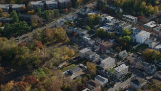 AX119_081 - 6K stock footage aerial video of an orbit of small town shops in Dobbs Ferry in Autumn, New York
