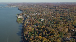 AX119_082 - 6K stock footage aerial video approach small riverfront town of Irvington in Autumn, New York