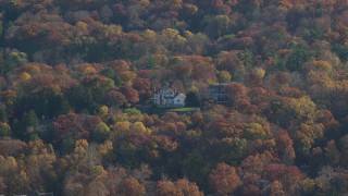 AX119_083 - 6K stock footage aerial video of a pair of mansions in Autumn, Irvington, New York