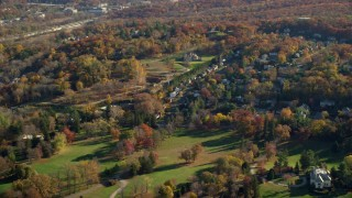AX119_085 - 6K stock footage aerial video of mansions and small town homes in Autumn, Tarrytown, New York