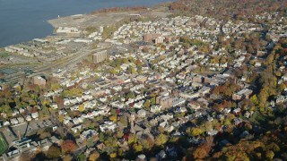 AX119_089 - 6K stock footage aerial video orbit riverfront town of Sleepy Hollow in Autumn, New York