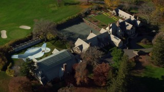 AX119_098 - 6K stock footage aerial video orbit guest house at Kykuit Estate in Autumn, Westchester County, New York