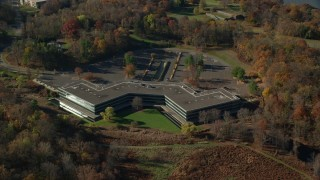 AX119_102 - 6K stock footage aerial video of an orbit of an isolated office building in Autumn, Sleepy Hollow, New York