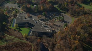 AX119_103 - 6K stock footage aerial video of circling an isolated office building in Autumn, Sleepy Hollow, New York