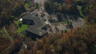AX119_104 - 6K stock footage aerial video of an orbit of an isolated office building in Autumn, Sleepy Hollow, New York