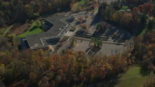 AX119_105 - 6K stock footage aerial video of an isolated office building in Autumn, Sleepy Hollow, New York