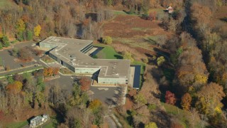 AX119_107 - 6K stock footage aerial video orbit an office building in Autumn, Sleepy Hollow, New York