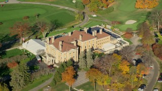 AX119_110 - 6K stock footage aerial video orbit historical mansion and country club in Autumn, Briarcliff Manor, New York