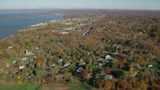 AX119_111 - 6K stock footage aerial video of a small riverfront town in Autumn, Briarcliff Manor and Ossining, New York