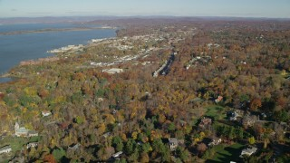 AX119_112 - 6K stock footage aerial video of a small riverfront town in Autumn, Briarcliff Manor and Ossining, New York
