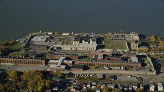 AX119_115 - 6K stock footage aerial video of orbiting the buildings of Sing Sing Prison in Autumn, Ossining, New York
