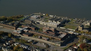 AX119_116 - 6K stock footage aerial video of an orbit of Sing Sing Prison in Autumn, Ossining, New York
