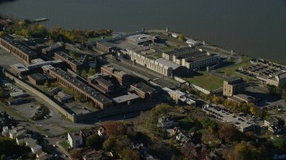 AX119_117 - 6K stock footage aerial video of orbiting the Sing Sing Prison complex in Autumn, Ossining, New York