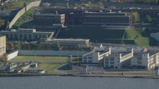 AX119_123 - 6K stock footage aerial video of Sing Sing Prison in Autumn, Ossining, New York