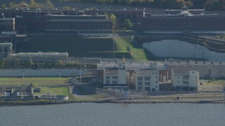 AX119_124 - 6K stock footage aerial video of buildings at Sing Sing Prison in Autumn, Ossining, New York
