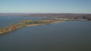 AX119_125 - 6K stock footage aerial video of approaching Croton Point Park in Autumn, Croton on Hudson, New York
