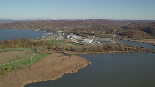 AX119_127 - 6K stock footage aerial video of a riverfront rail station in Autumn, Croton on Hudson, New York