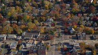 AX119_130 - 6K stock footage aerial video of homes near a small town street intersection in Autumn, Croton on Hudson, New York