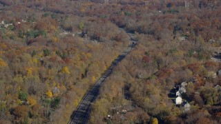 AX119_135 - 6K stock footage aerial video of a tree-lined highway in Autumn, Croton on Hudson, New York