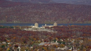 AX119_137 - 6K stock footage aerial video of Indian Point Nuclear Power Plant in Autumn, Buchanan, New York