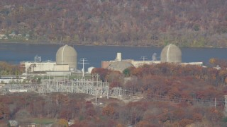 AX119_138 - 6K stock footage aerial video of the Indian Point Nuclear Power Plant in Autumn, Buchanan, New York