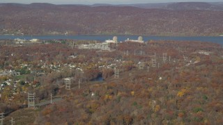 AX119_140 - 6K stock footage aerial video of a view of Indian Point Nuclear Power Plant in Autumn, Buchanan, New York