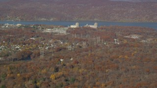 AX119_141 - 6K stock footage aerial video of Indian Point Nuclear Power Plant in Autumn, Buchanan, New York