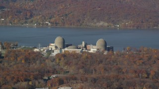 AX119_143 - 6K stock footage aerial video of the riverfront Indian Point Nuclear Plant in Autumn, Buchanan, New York