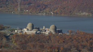 AX119_144 - 6K stock footage aerial video of an orbit of the Indian Point Nuclear Plant in Autumn, Buchanan, New York